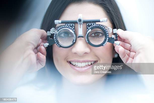 Young female having her eyes examined