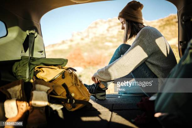 young female hiker getting ready for adventure - women trying on shoes stock pictures, royalty-free photos & images