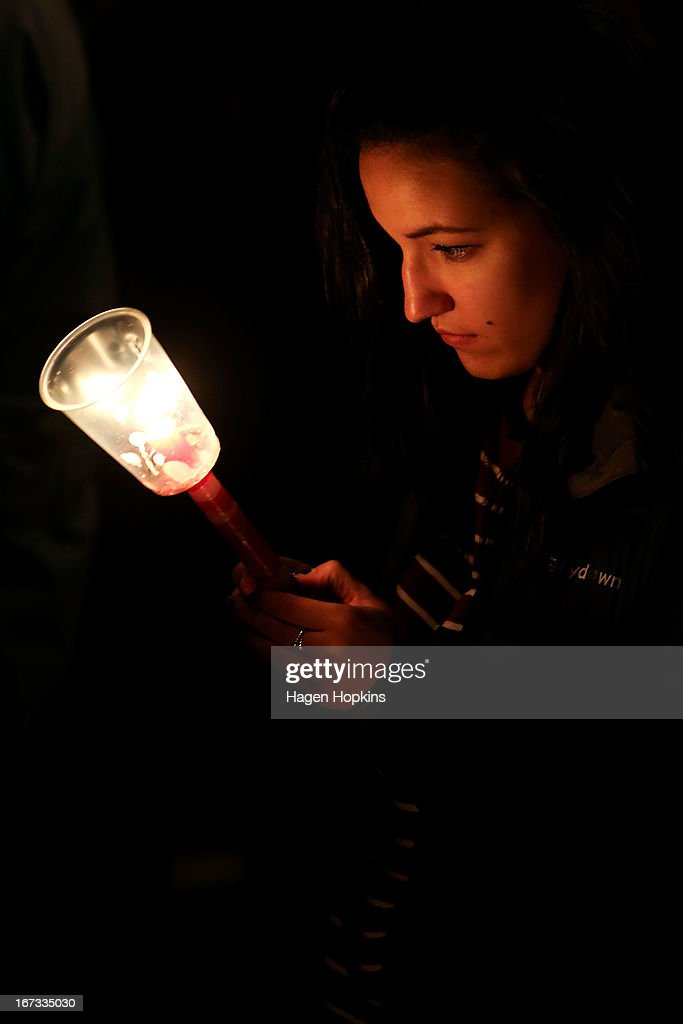 A young female holds a candle during dawn service at the Wellington cenotaph on April 25, 2013 in Wellington, New Zealand. Veterans, dignitaries and members of the public marked the 98th anniversary of ANZAC (Australia New Zealand Army Corps) Day, April 25, 1915 when allied New Zealand and Australian forces landed on the Gallipoli Peninsula during the First World War.