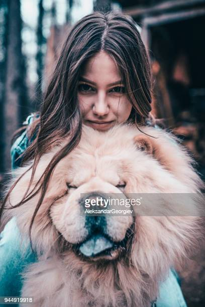 Young Female Hugging her Chow Chow Dog on a Mountain Picnic