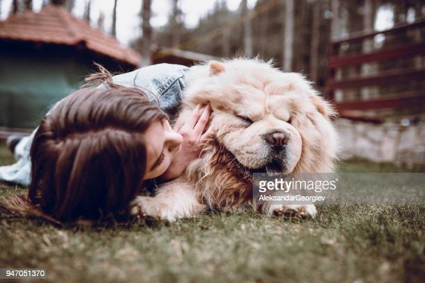 young female hugging her chow chow dog on a mountain picnic - chow dog stock pictures, royalty-free photos & images
