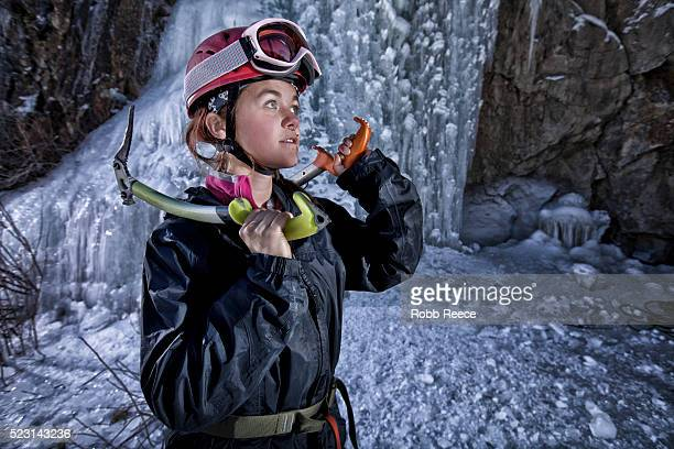 young female ice climber with ice tools - robb reece stock-fotos und bilder