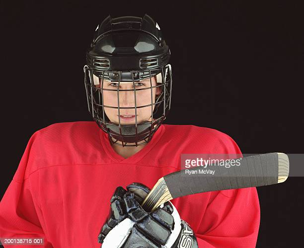 young female ice hockey player, portrait - ice hockey uniform stock pictures, royalty-free photos & images