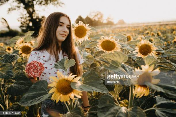 Young female in a sunflower field
