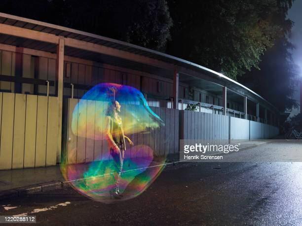 young female in soapbubble - people inside bubbles stock pictures, royalty-free photos & images
