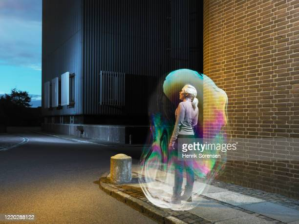 young female in soapbubble - protection stock pictures, royalty-free photos & images