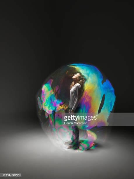 young female in soapbubble - verlaten begrippen stockfoto's en -beelden