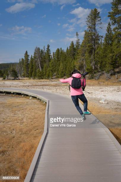 Young female jumping off Yellowstone National Park