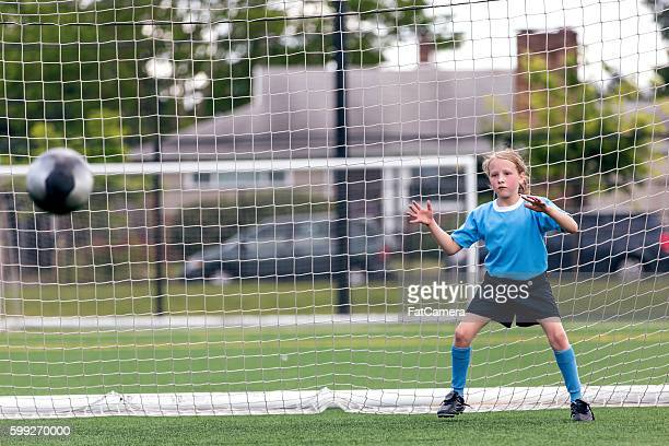 young female keeper attempts to block a goal - fat goalkeeper stock pictures, royalty-free photos & images