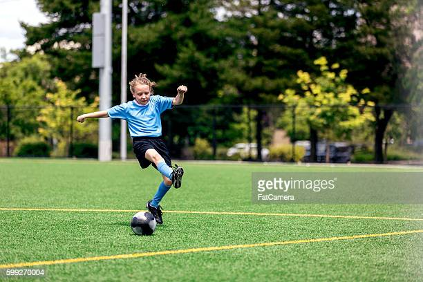 young female kicking a soccer goal - fat goalkeeper stock pictures, royalty-free photos & images