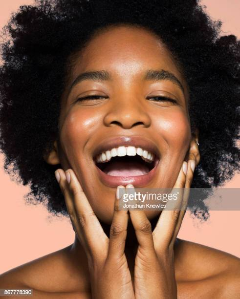 young female laughing - glowing stock pictures, royalty-free photos & images