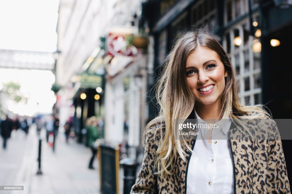Young Female Lifestyle Blogger posing in street in Central London : Stock Photo
