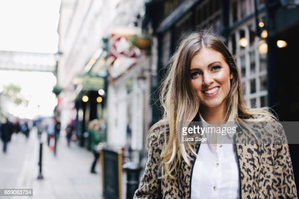 Young Female Lifestyle Blogger posing in street in Central London