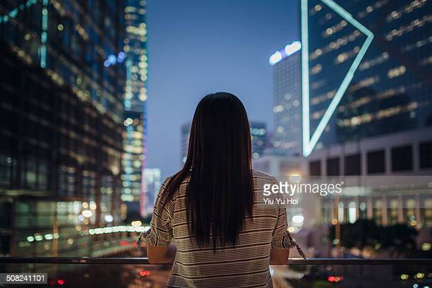 Young female looking far away in thought in city