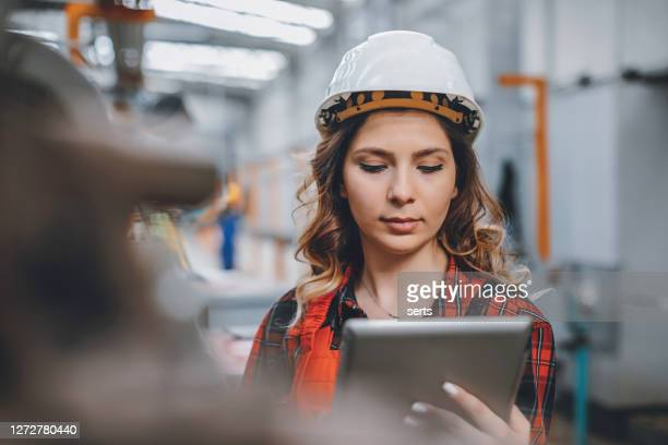 young female maintenance engineer working with digital tablet - touchpad stock pictures, royalty-free photos & images