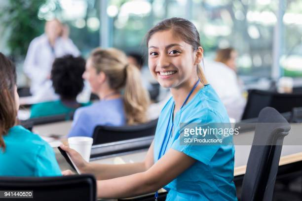 Young female medical student smiles for camera