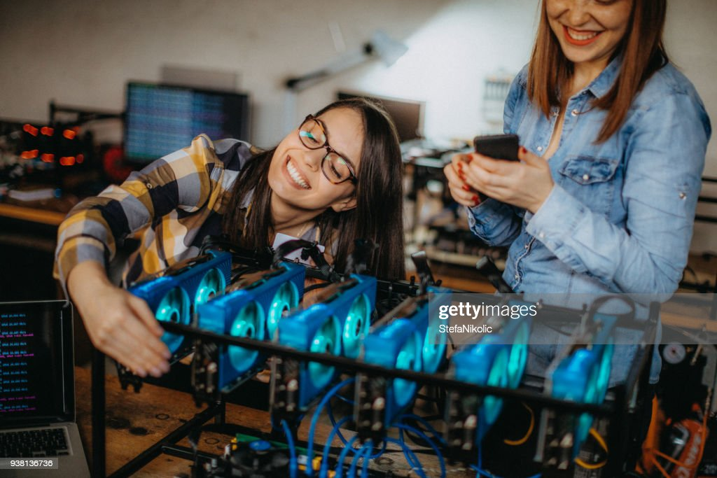 Young female miners celebrating success : Stock Photo