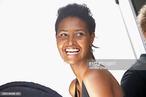 Young female model on set during photo shoot, smiling