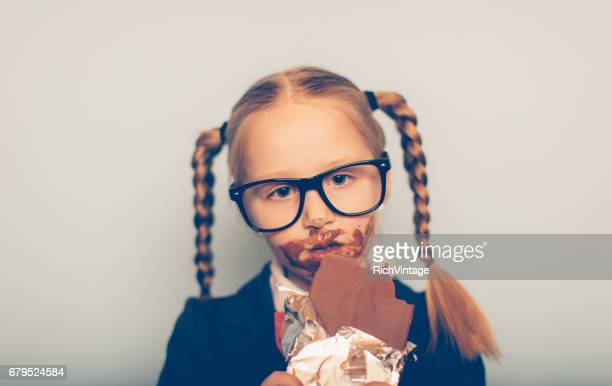Young Female Nerd Eats Chocolate Bar