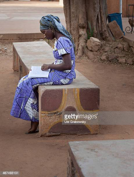 Young female Nigerian student reading in a booklet on December 04 in Niamey Niger Photo by Ute Grabowsky/Photothek via Getty Images
