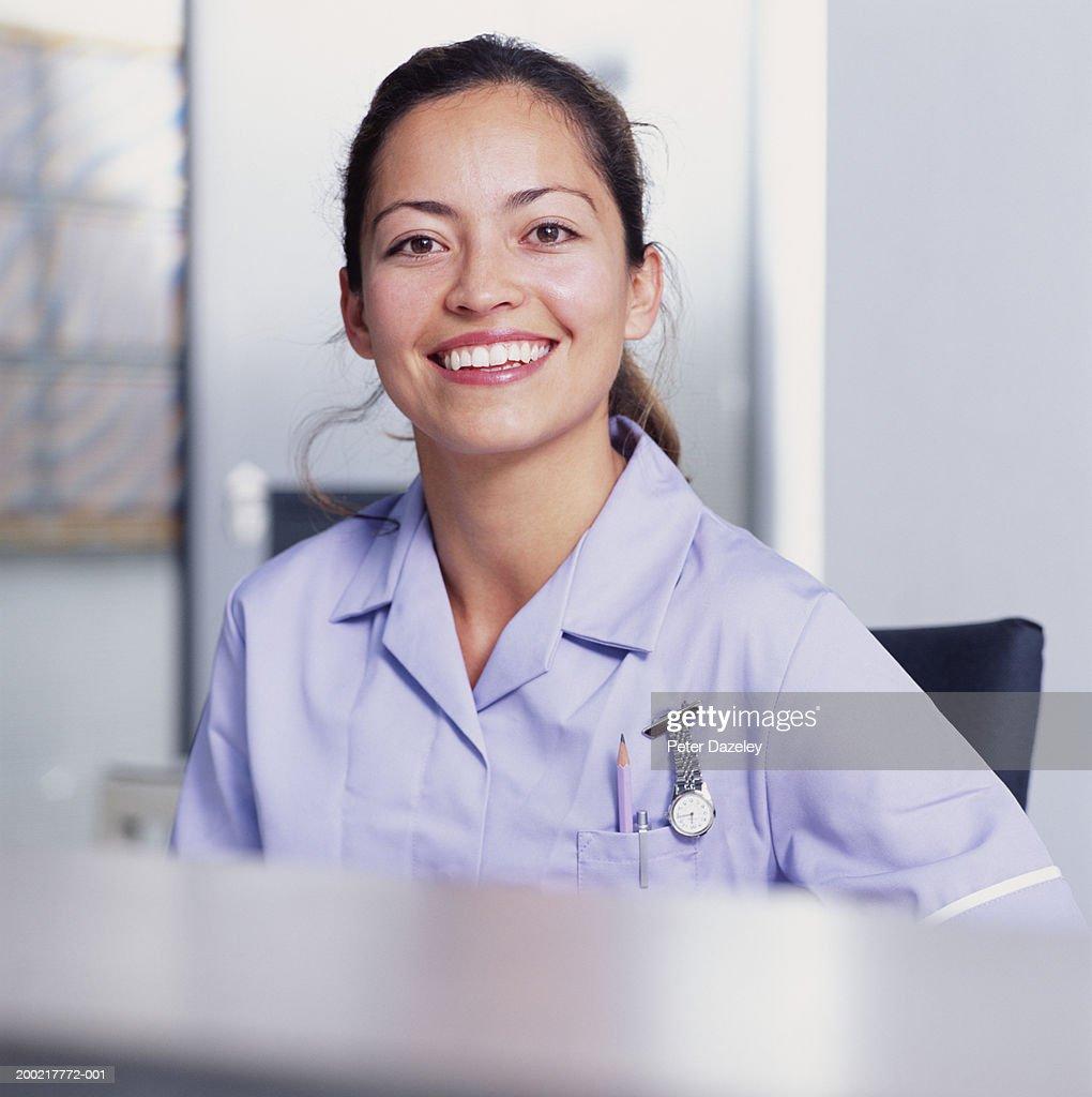 Smiling Nurse Taking Notes Stock Photo - Download Image