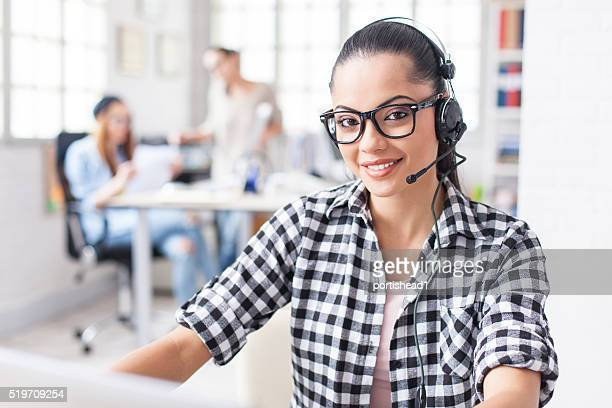 Young female office worker with headset