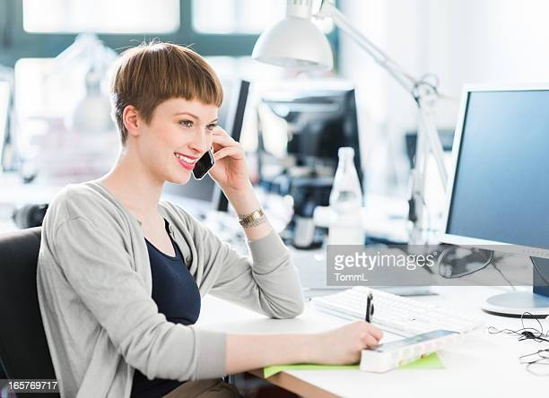 Young Female Office Worker With Smart Phone