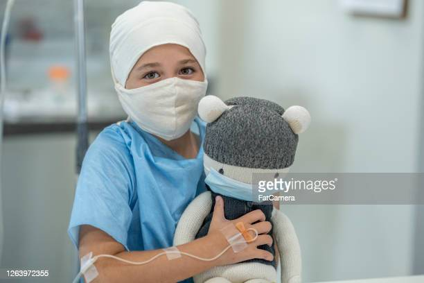 young female oncology patient wearing mask - leukemia stock pictures, royalty-free photos & images