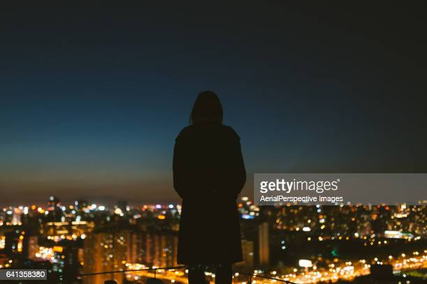 Young female overlooking the stunning view of city