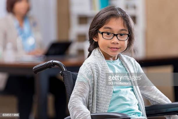 Young female patient in wheelchair