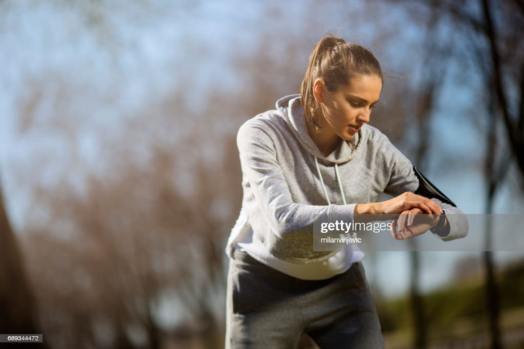 Young female preparing for running in nature : Stock Photo