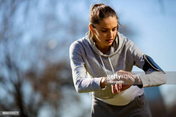 Young female preparing for running in park