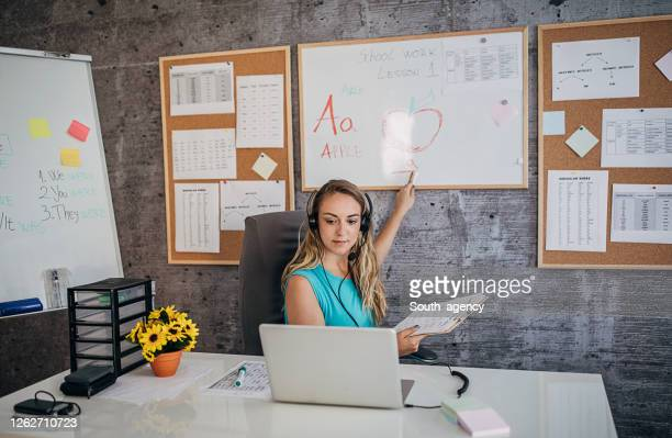 young female professor holding online class for e-learning students - teaching stock pictures, royalty-free photos & images