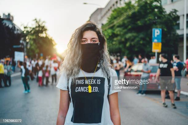 young female protester - black lives matter stock pictures, royalty-free photos & images