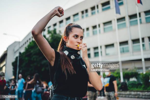 young female protester - protestor stock pictures, royalty-free photos & images