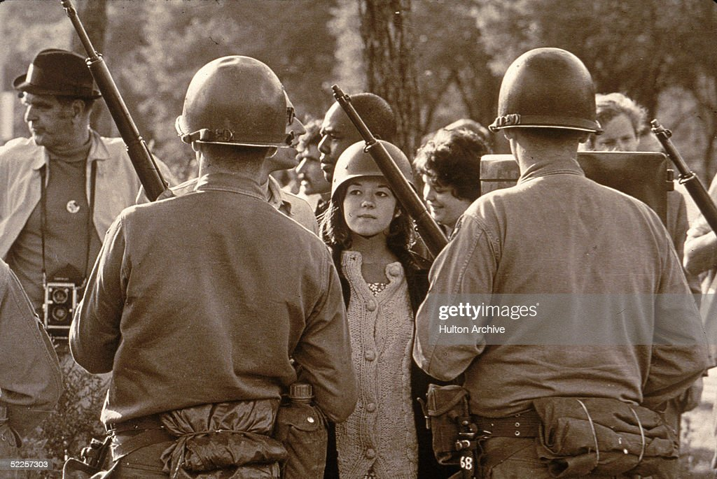 Protestor Eyes Riot Police Outside 1968 Democratic National Convention : News Photo