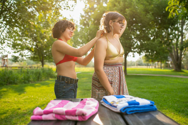 Young female same sex couple outdoors in park