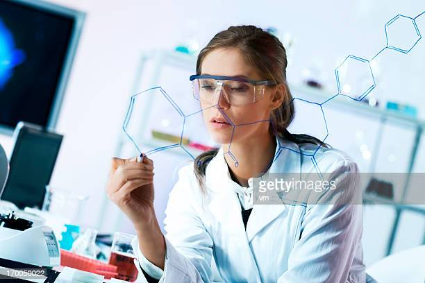 Young Female Scientist Drawing a Molecular Structure