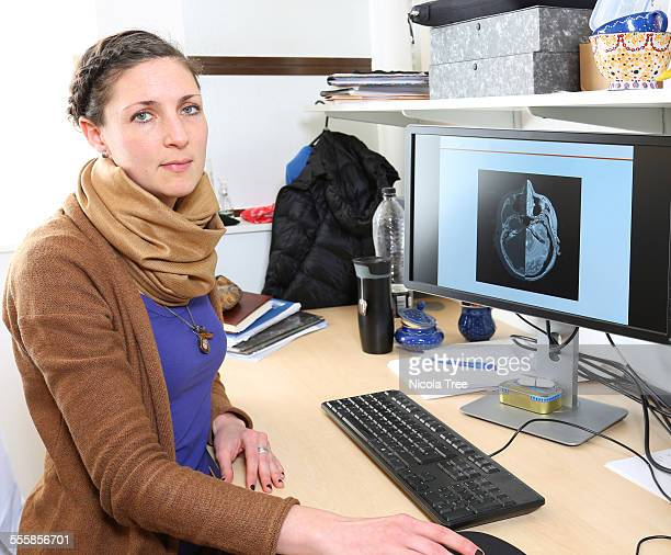 young female scientist working in her office - medical procedure stock pictures, royalty-free photos & images