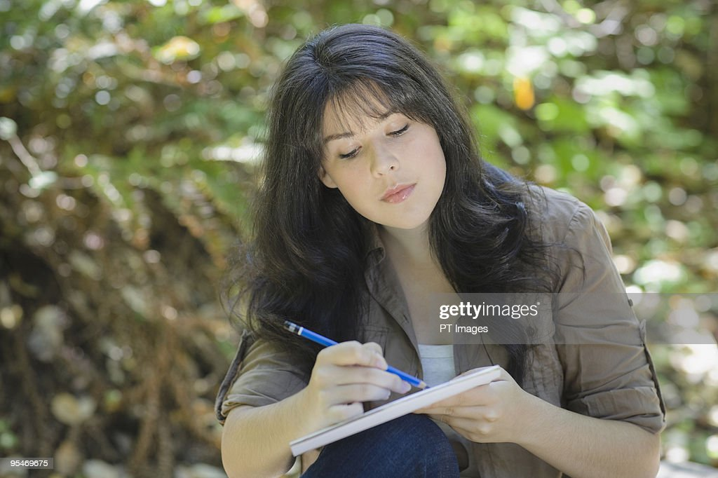 Young female sketching : Stock Photo