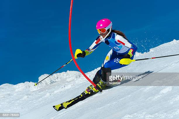 young female slalom skier during the race - ski racing stock pictures, royalty-free photos & images