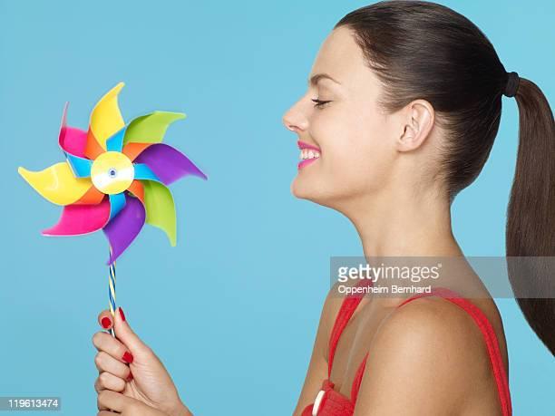 young female smiling at pinwheel