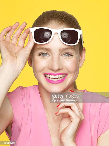 young female smiling with sun glasses on her head
