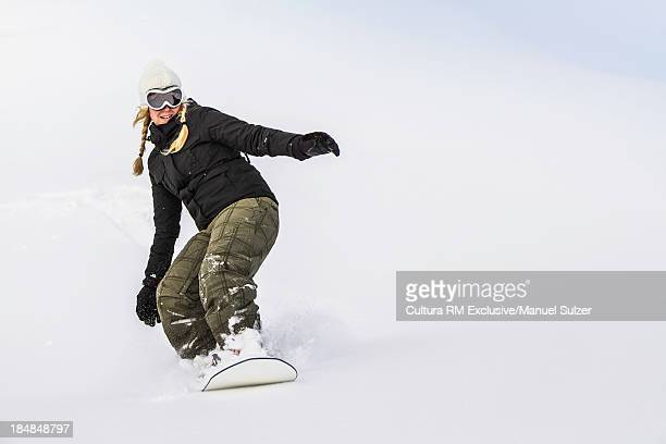 Young female snowboarding, Reutte, Tyrol, Austria