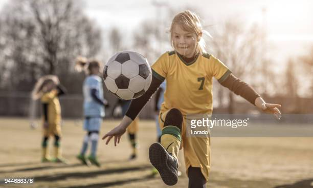 young female soccer girl posing for a player photo during football training - football stock pictures, royalty-free photos & images