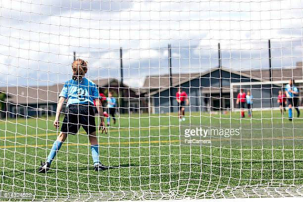 young female soccer keeper defending her teams net - fat goalkeeper stock pictures, royalty-free photos & images