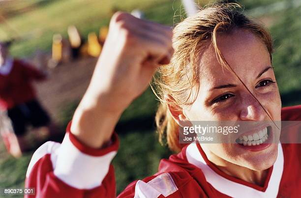 Young female soccer player cheering