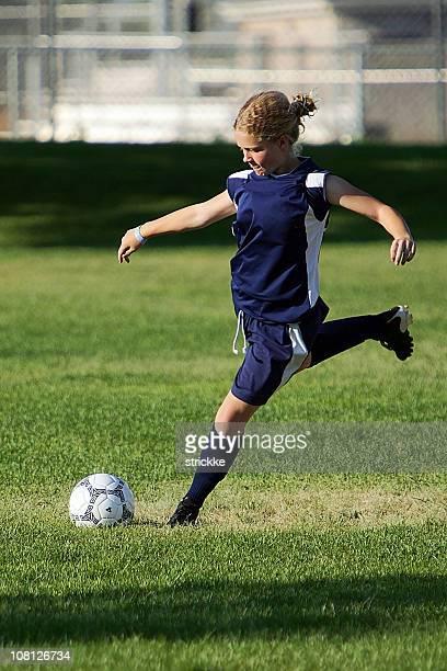 young female soccer player strikes a power hit profile - anfallsspelare fotboll bildbanksfoton och bilder