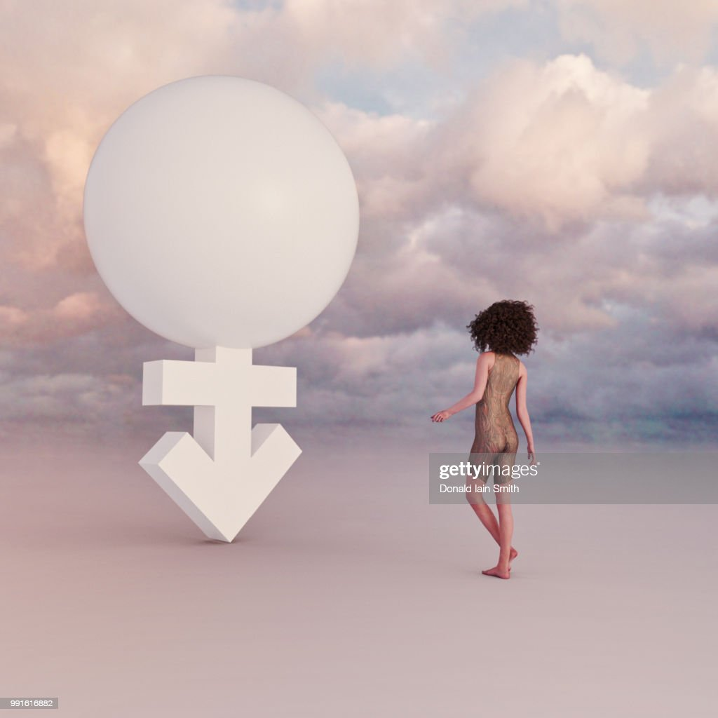Young female standing beside transgender symbol : Stock Photo