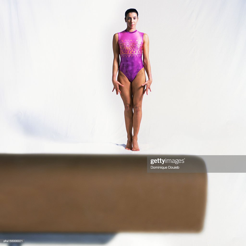 Young female standing in front of pommel horse. : Stockfoto